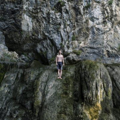 LIVNO - BOSNIA-HERZEGOVINA 2015: A young boy prepares to jump into freezing waters at the source of river Bistrica. Livno is the town that has seen some of the largest post war migration of the population. Over one milion people left Bosnia-Herzegovina from 1991. (Photo by Ziyah Gafic)